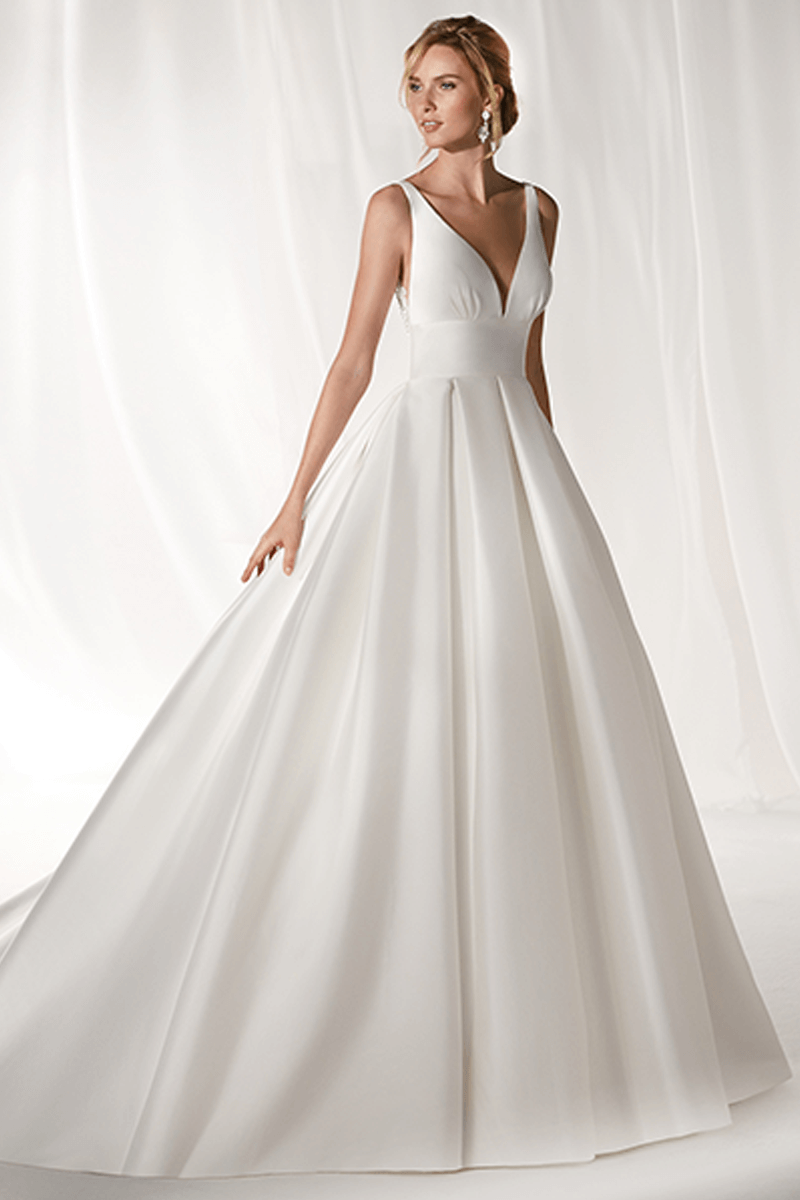 V-neck A-line satin wedding gown with back details | Bycouturier